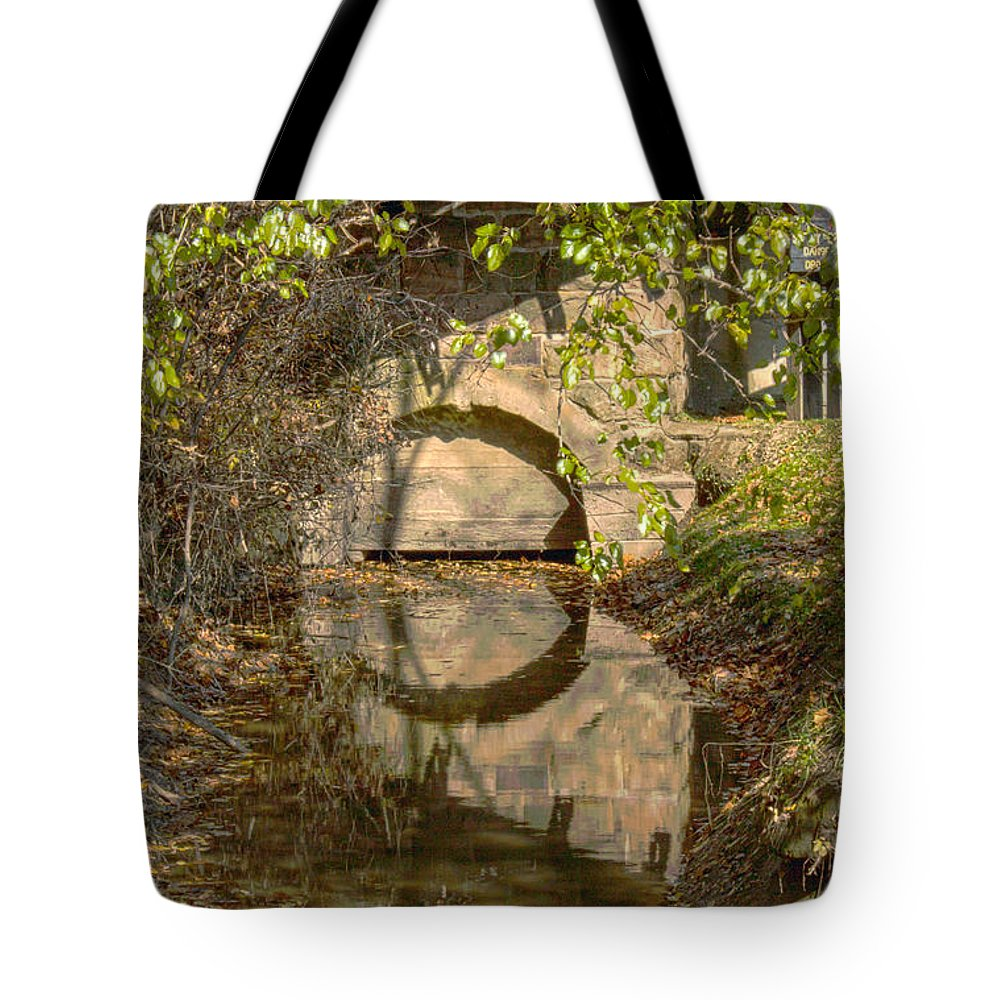 Mansfield Mill Tote Bag featuring the photograph Outlet At The Mill by Thomas Sellberg