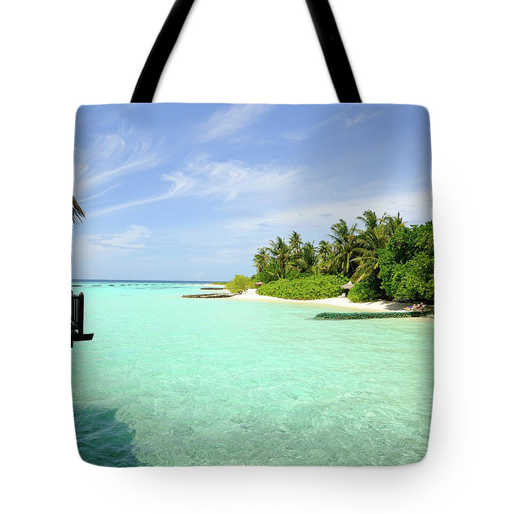 Seascape Tote Bag featuring the photograph Outlook On A Maldives Island by Wolfgang steiner