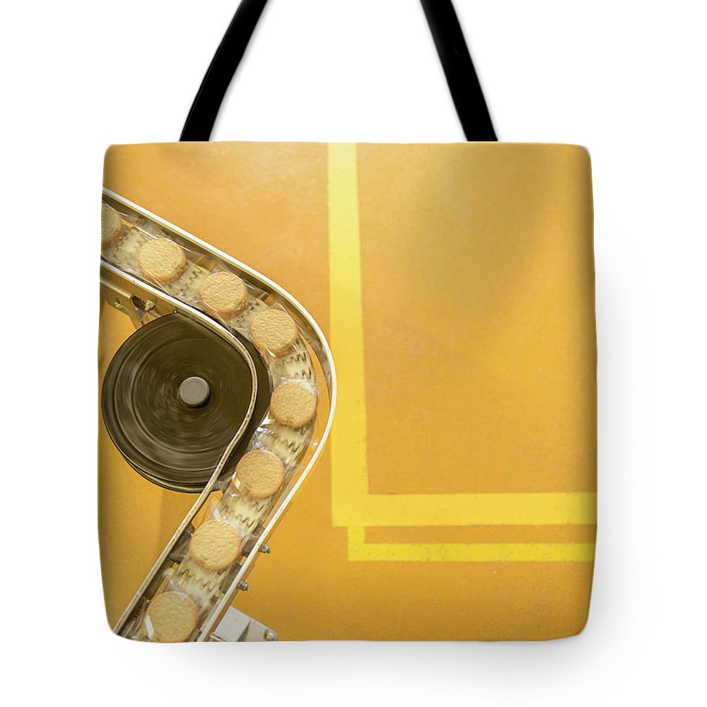 Manufacturing Equipment Tote Bag featuring the photograph Overhead View Of Freshly Made Biscuits by Monty Rakusen