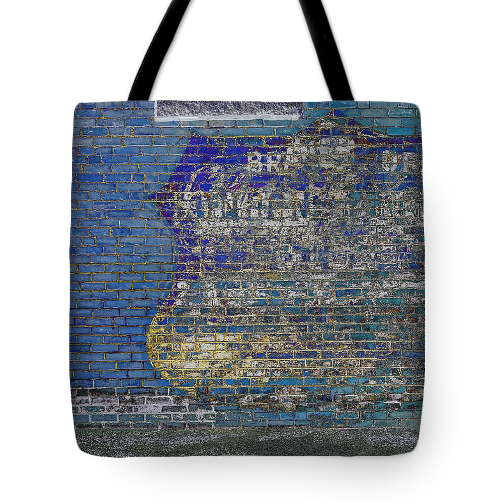 Brick Tote Bag featuring the photograph Painted Sign On A Brick Wall by David Stone