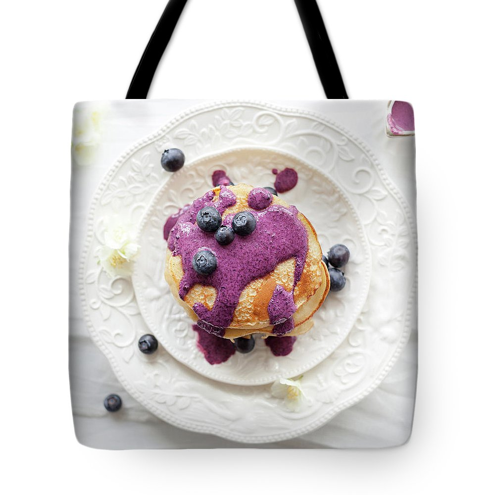 Temptation Tote Bag featuring the photograph Pancakes With Blueberry Sauce by Ingwervanille