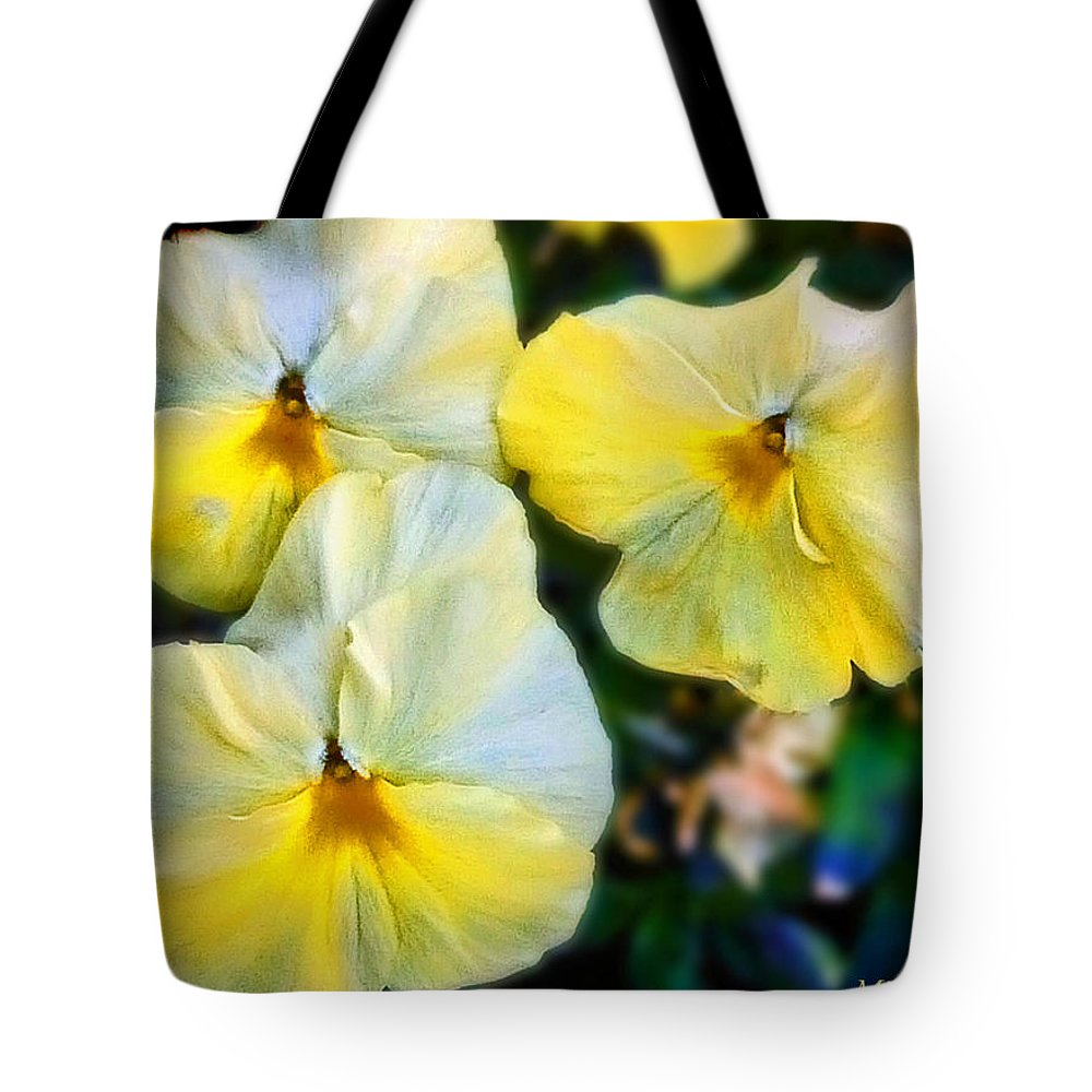 Floral Tote Bag featuring the photograph Pansies by Mikki Cucuzzo