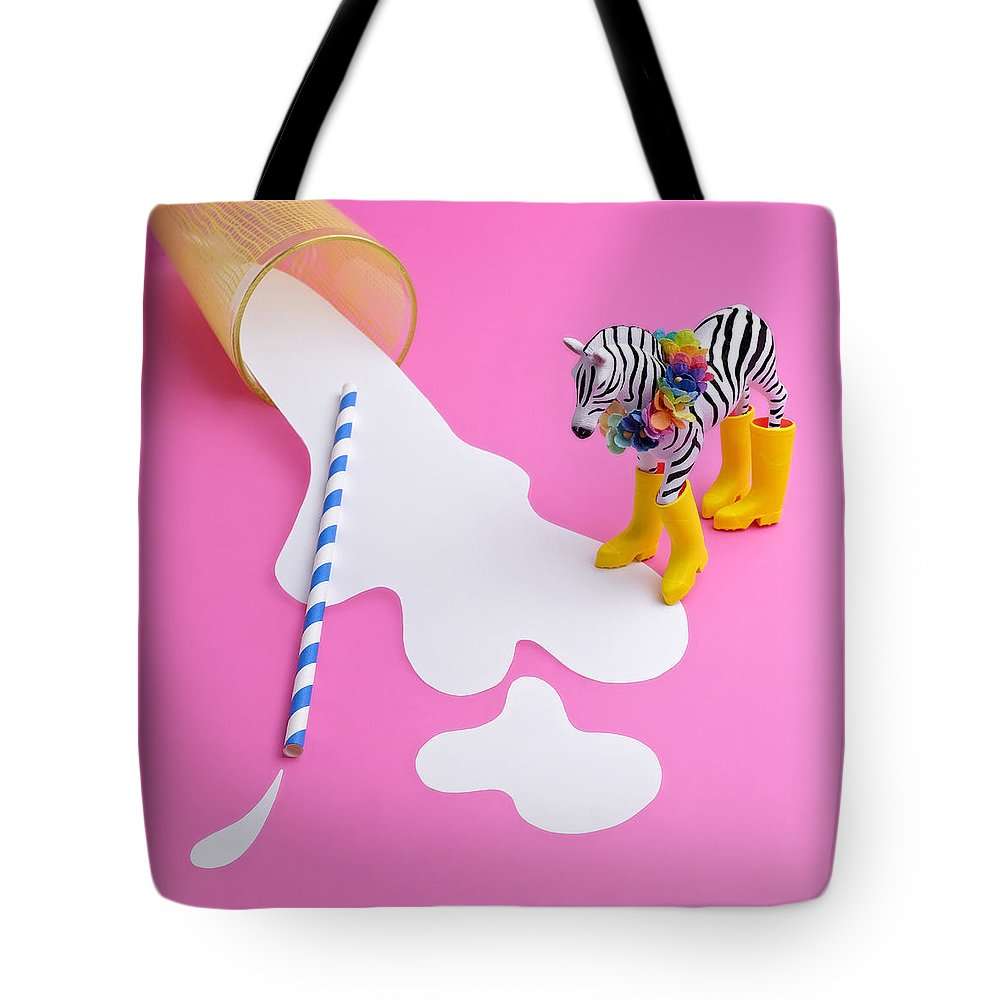 Milk Tote Bag featuring the photograph Paper Craft Glass Of Spilled Milk With by Juj Winn