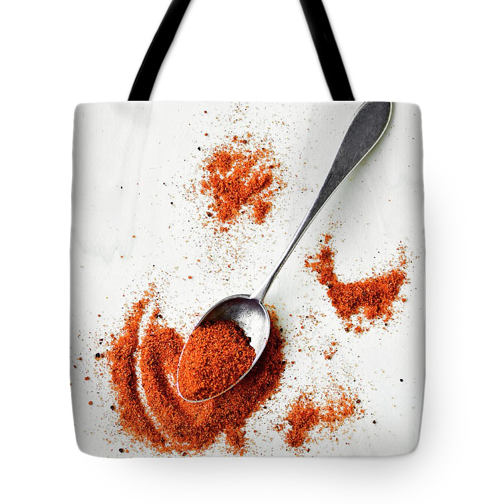 Atlanta Tote Bag featuring the photograph Paprika Powder In A Spoon by Natalia Ganelin
