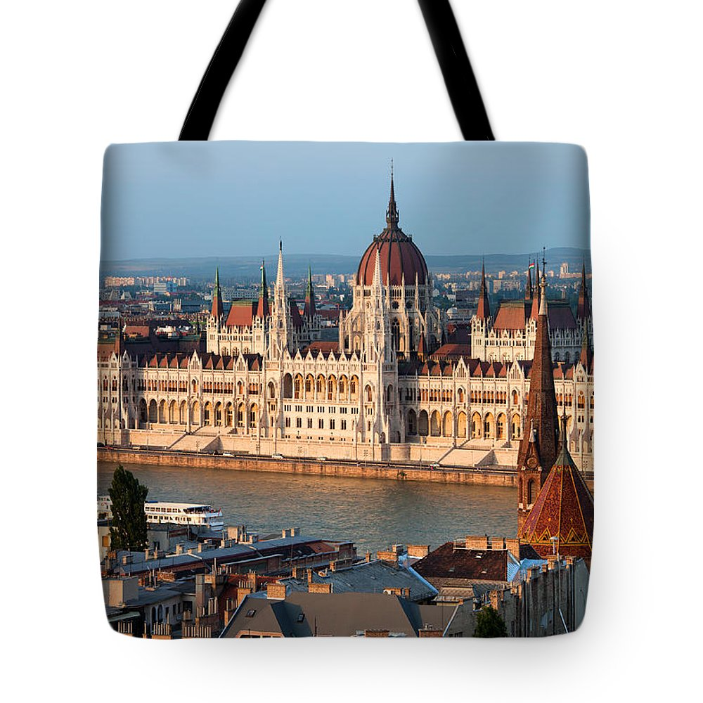 Architectural Tote Bag featuring the photograph Parliament Building In Budapest At Sunset by Artur Bogacki