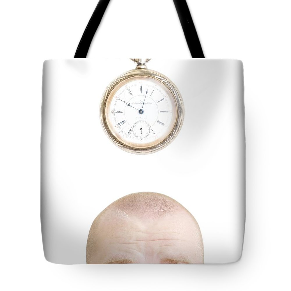 30-35 Years Tote Bag featuring the photograph Part Of A Mans Head And A Stop Watch by Chris and Kate Knorr