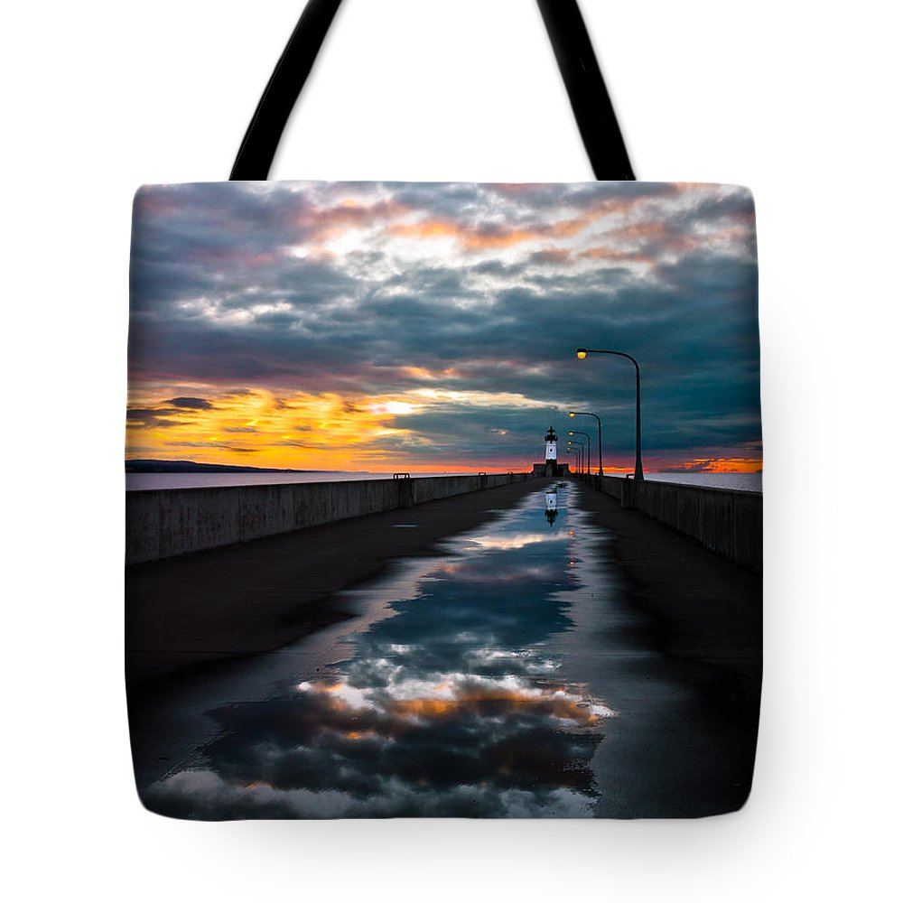 pathway To The Sun after The Rains lake Superior Sunrise reflection sunrise canal Park canal Park Lighthouse Duluth dawn On Lake Superior dawn In Canal Park wow pure Magic!greeting Cardslandscape Greeting Cards nature Greeting Cards Tote Bag featuring the photograph Pathway To The Sun by Mary Amerman
