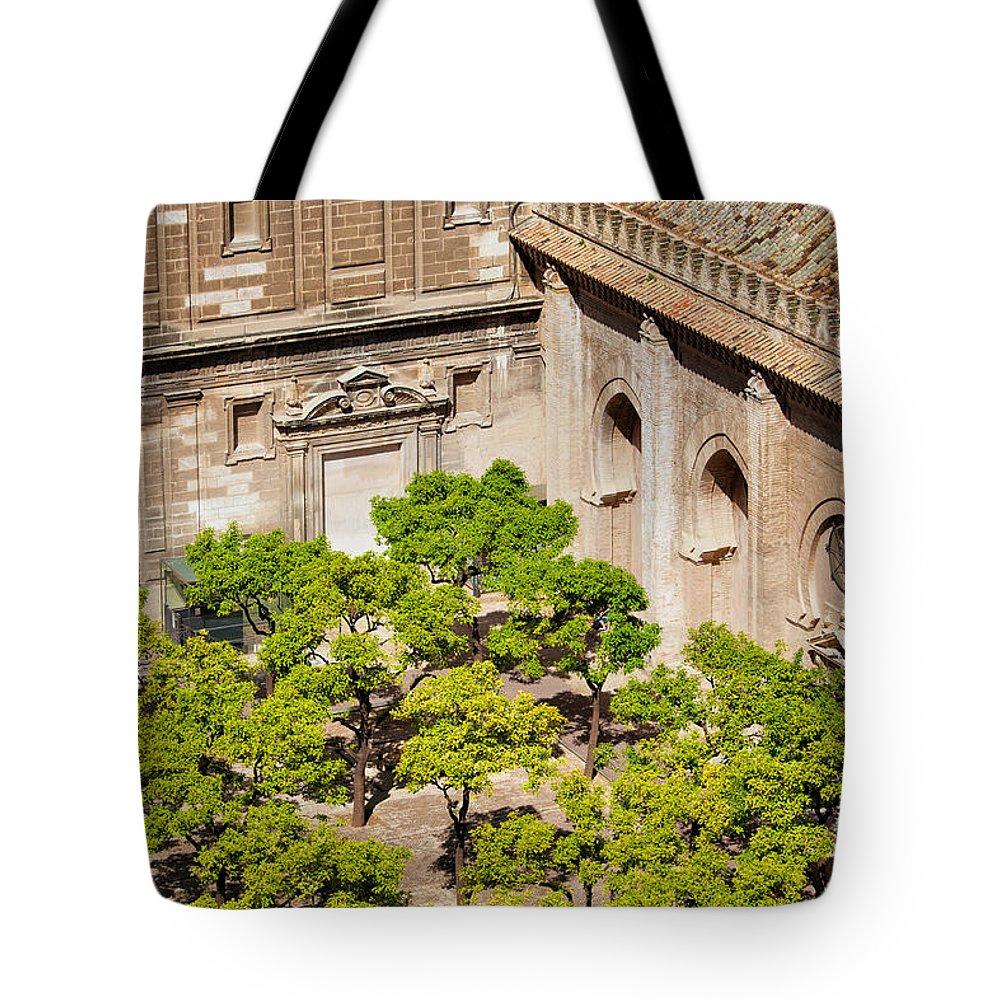 Garden Tote Bag featuring the photograph Patio De Los Naranjos Of Seville Cathedral by Artur Bogacki