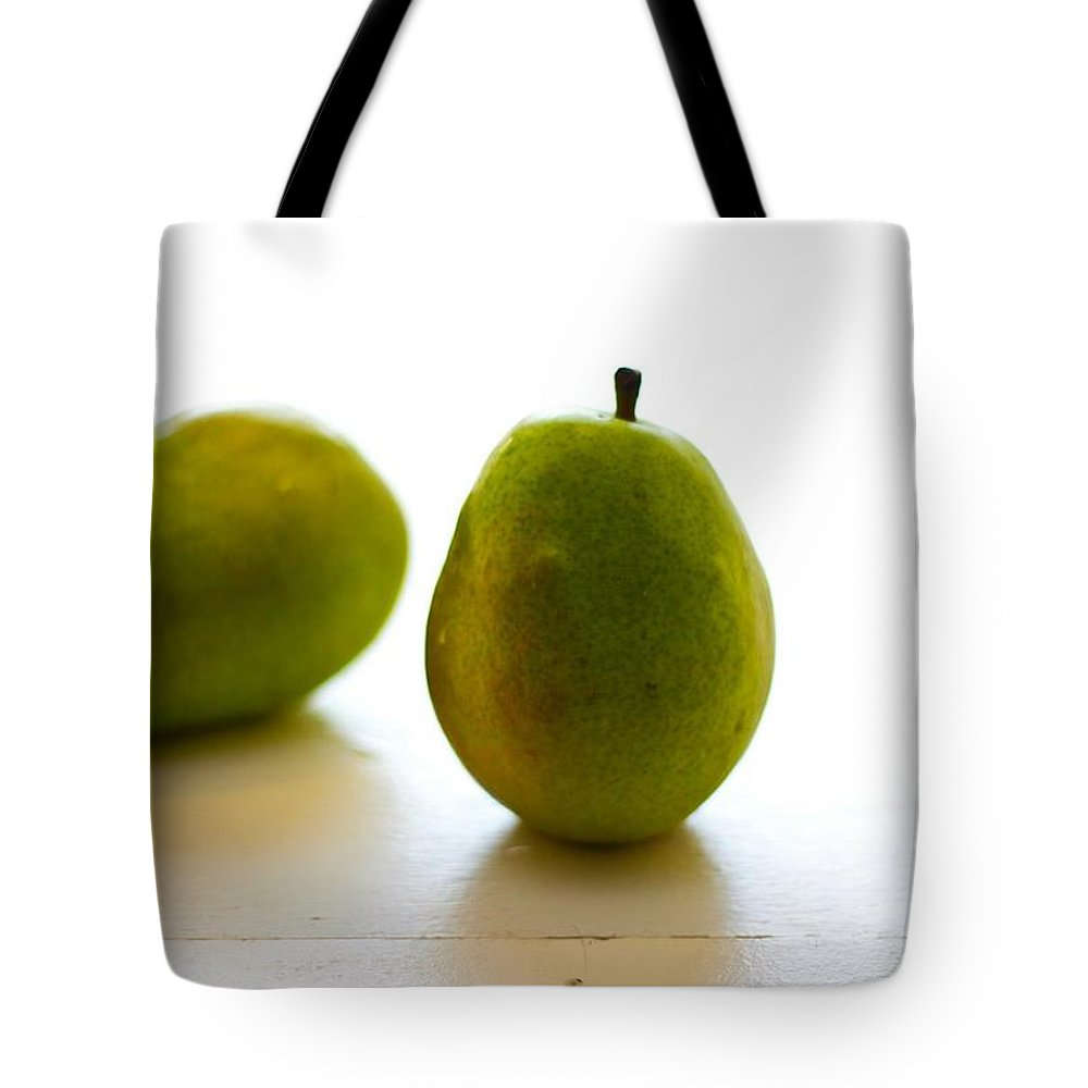 Green Tote Bag featuring the photograph Pears On A White Background by Kathleen Odenthal