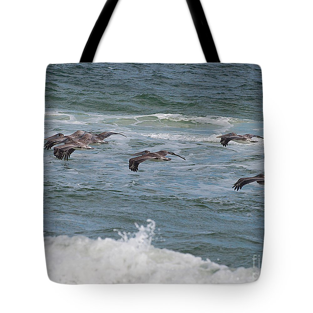 Pelicans Tote Bag featuring the photograph Pelicans Over The Water by Photos By Cassandra