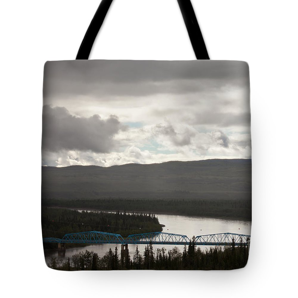 Blue Tote Bag featuring the photograph Pelly Crossing River Bridge Yukon Territory Canada by Stephan Pietzko