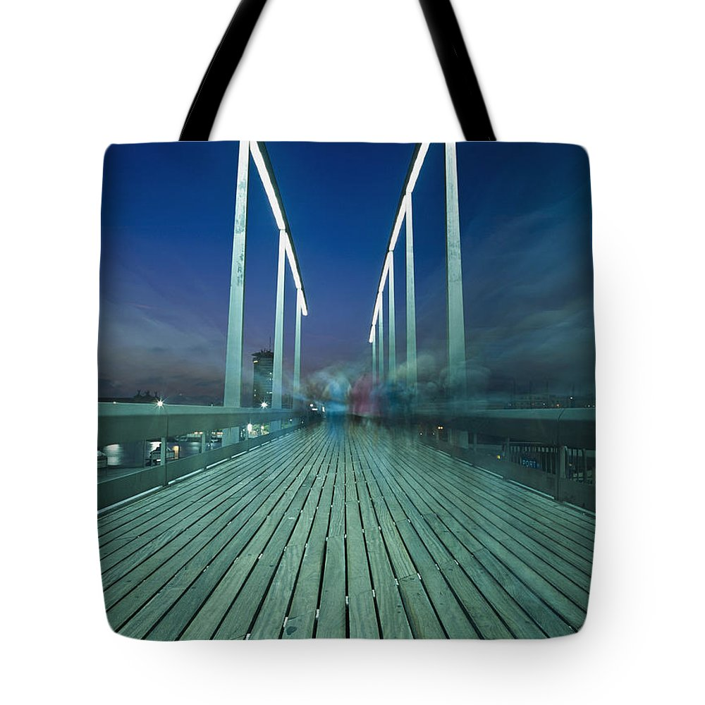 Color Image Tote Bag featuring the photograph People On Swing Bridge At Dusk, Blurred by Ian Cumming
