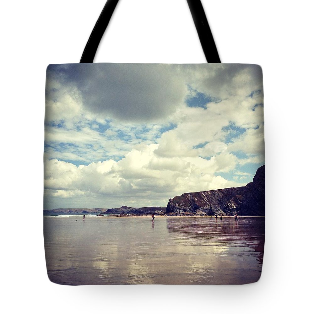 Mud Tote Bag featuring the photograph People Walking On Wet Sand On Cloudy by Jodie Griggs