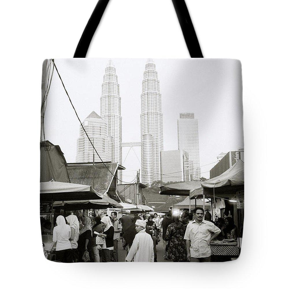 Kampung Baru Tote Bag featuring the photograph Petronas Over Kampung Baru by Shaun Higson