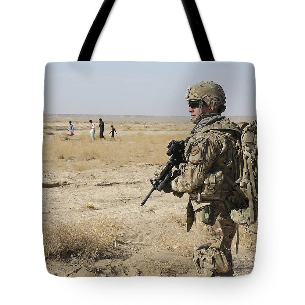 Afghanistan Tote Bag featuring the photograph Petty Officer Maintains Security by Stocktrek Images