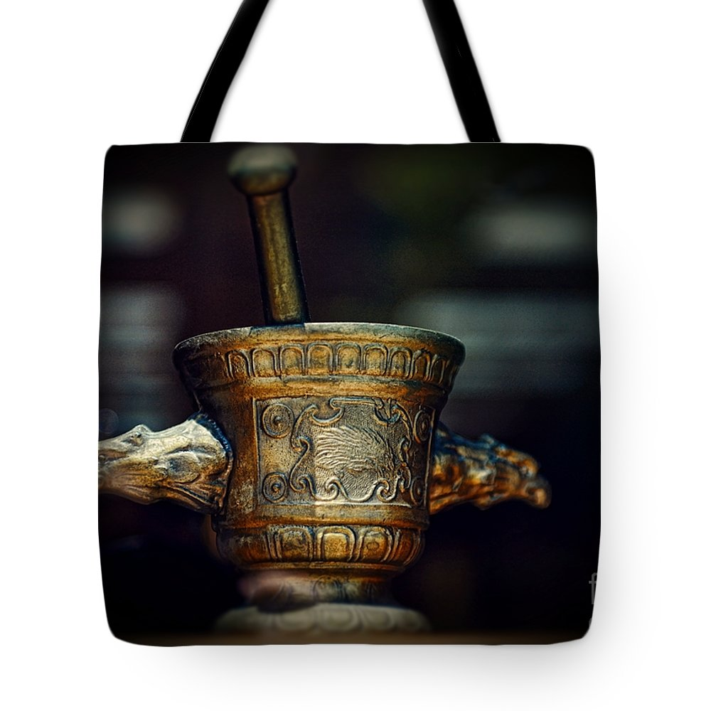 Paul Ward Tote Bag featuring the photograph Pharmacy Brass Mortar And Pestle With Eagle Handles by Paul Ward