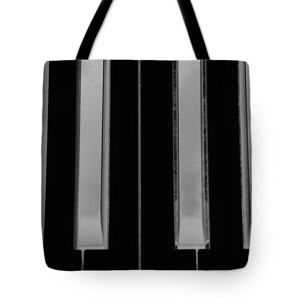 Piano Tote Bag featuring the photograph Piano Keys In Negative by Rob Hans