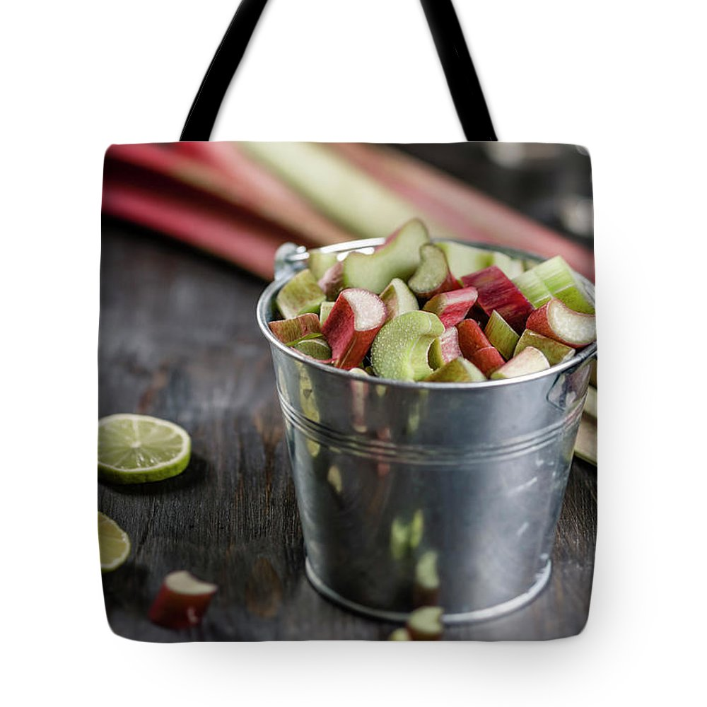 Bucket Tote Bag featuring the photograph Pieces Of Rhubarb In Metal Bucket And by Westend61