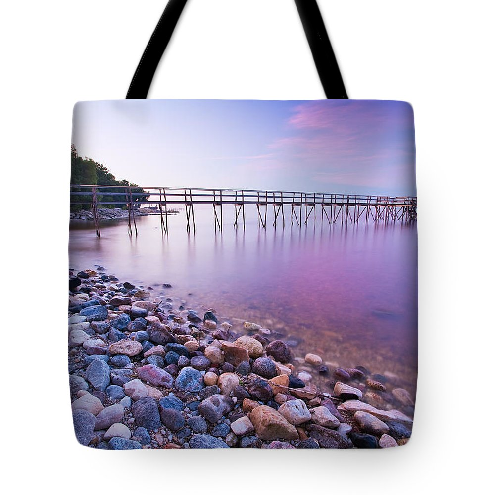 Light Tote Bag featuring the photograph Pier And Shoreline Of Lake Winnipeg by Ken Gillespie