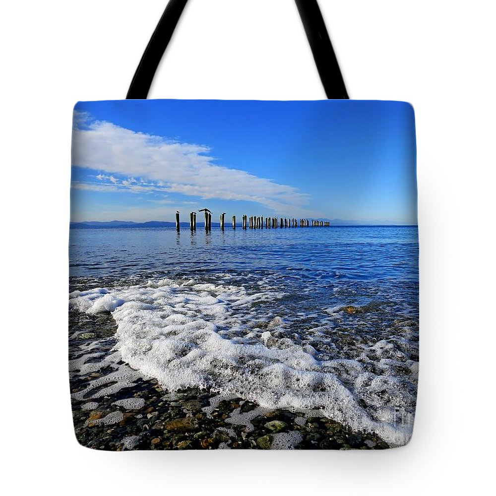 Beach Tote Bag featuring the photograph Pilings In The Ocean by Lena Photo Art