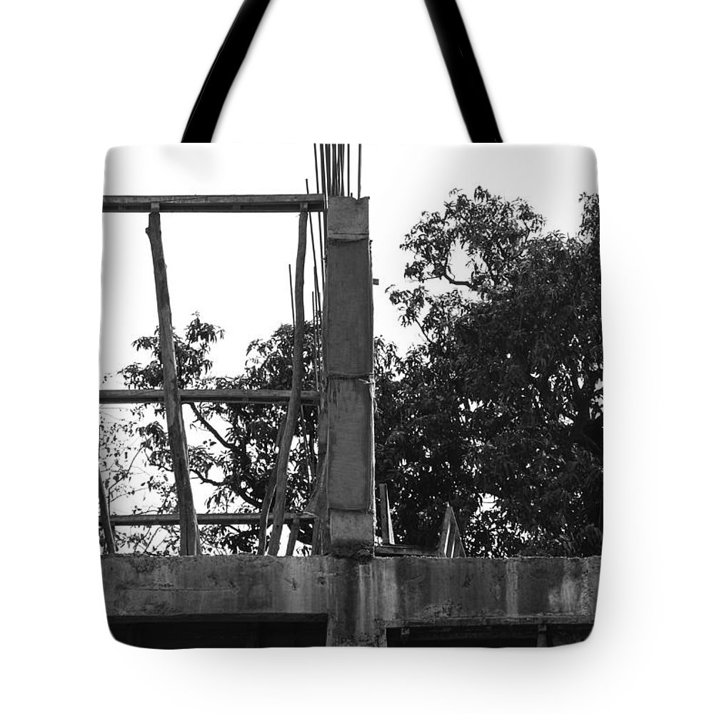 Bamboo Tote Bag featuring the photograph Pillars Of An Under Construction Building Covered By Sacks by Ashish Agarwal