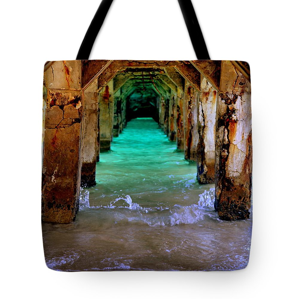 Waterscapes Tote Bag featuring the photograph Pillars Of Time by Karen Wiles