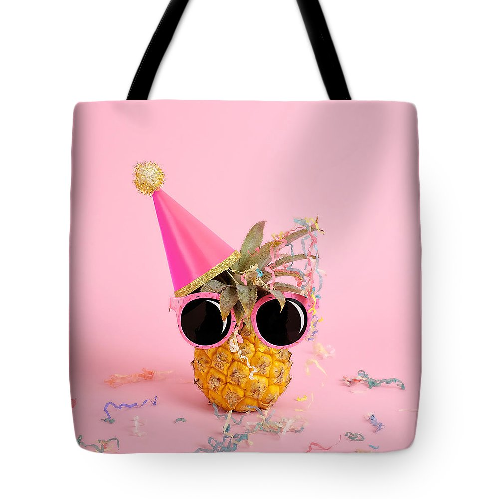 Celebration Tote Bag featuring the photograph Pineapple Wearing A Party Hat And by Juj Winn