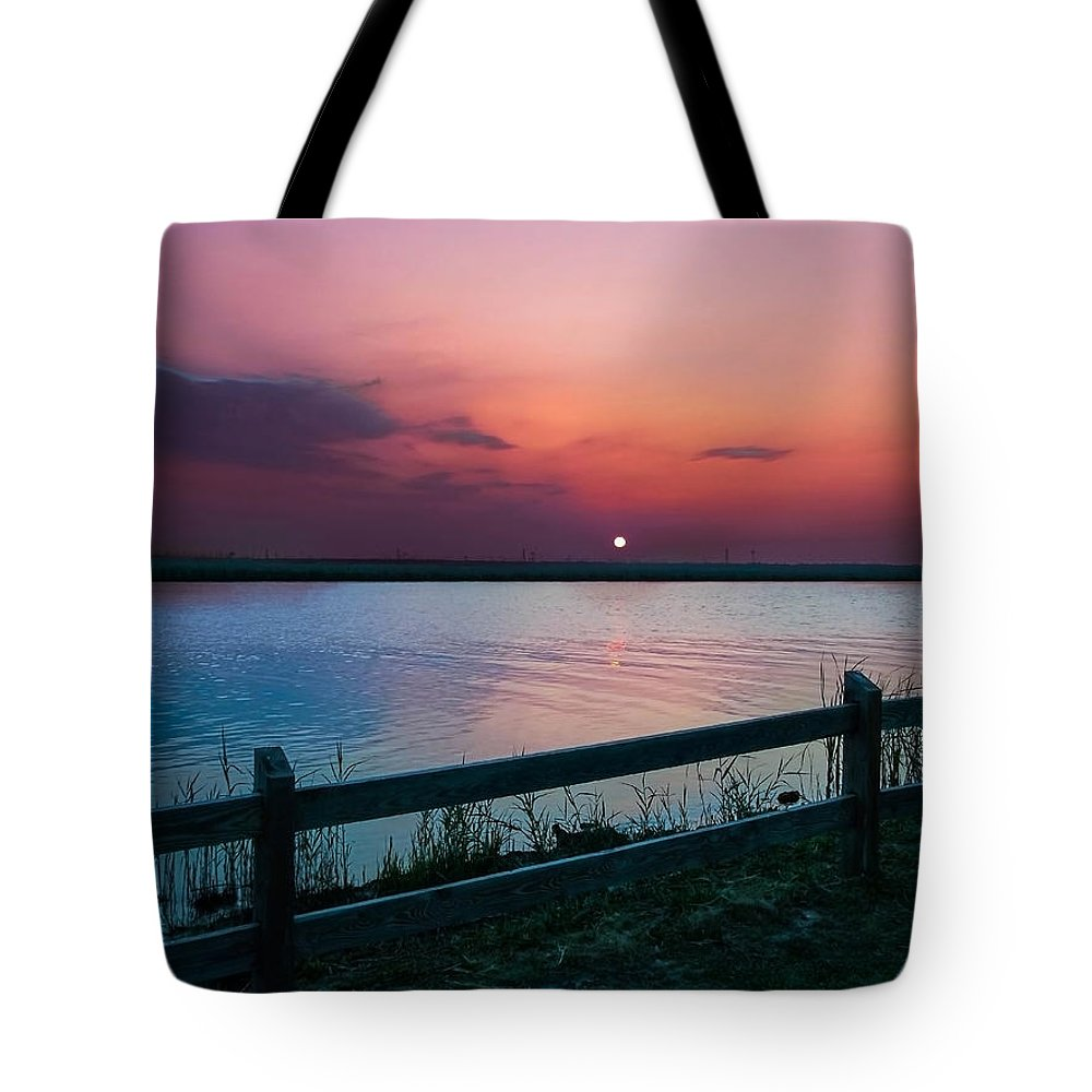 Pink Sunset Tote Bag featuring the photograph Pink Sunset by Mechala Matthews