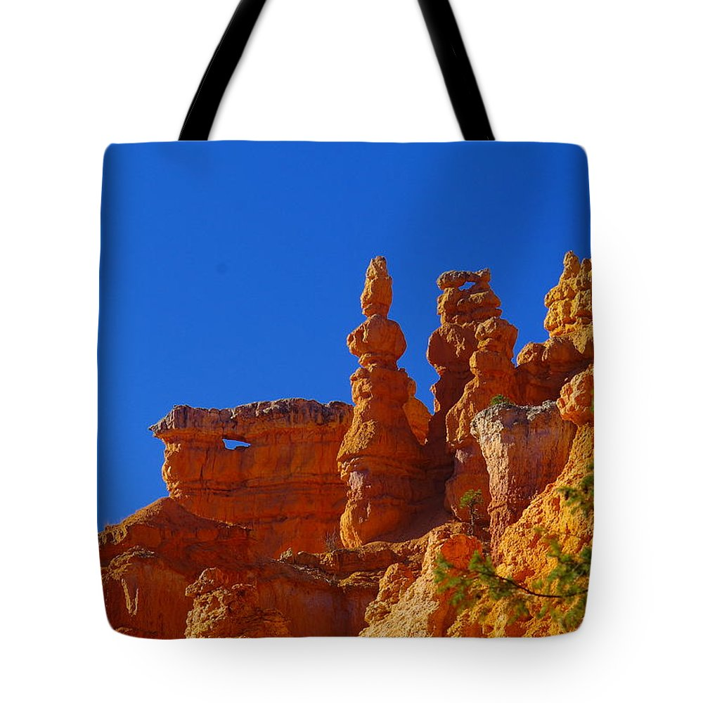 Pinnacles Tote Bag featuring the photograph Pinnacles Of Red Rock by Jeff Swan