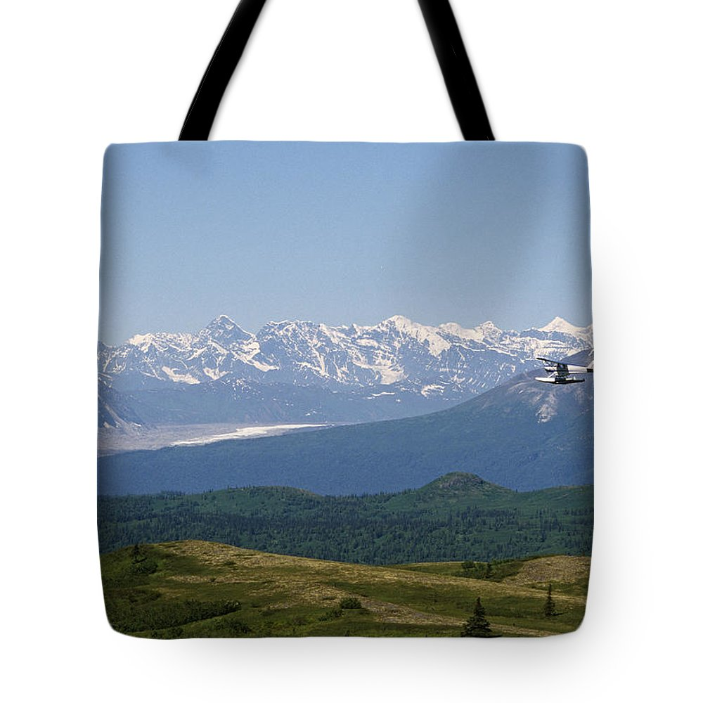 Flying Tote Bag featuring the photograph Piper Supercub On Floats Over Ak  Range by Jeff Schultz fa7c046fc2a3f