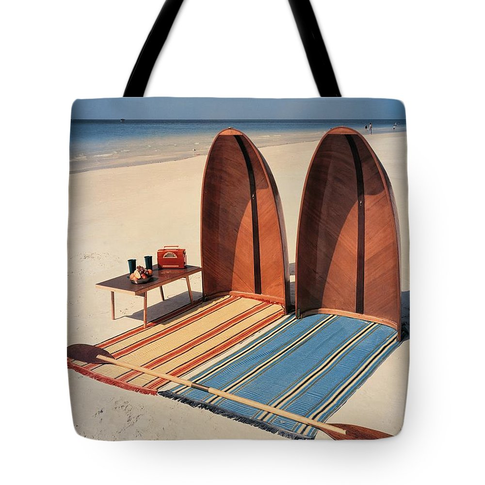 Accessories Tote Bag featuring the photograph Pixie Collapsible Boat On The Beach by Lois and Joe Steinmetz