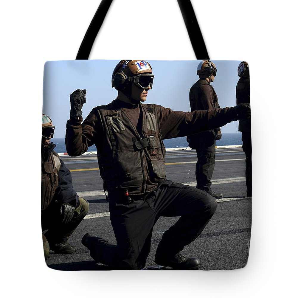 Military Tote Bag featuring the photograph Plane Captains Signal For The Start by Stocktrek Images