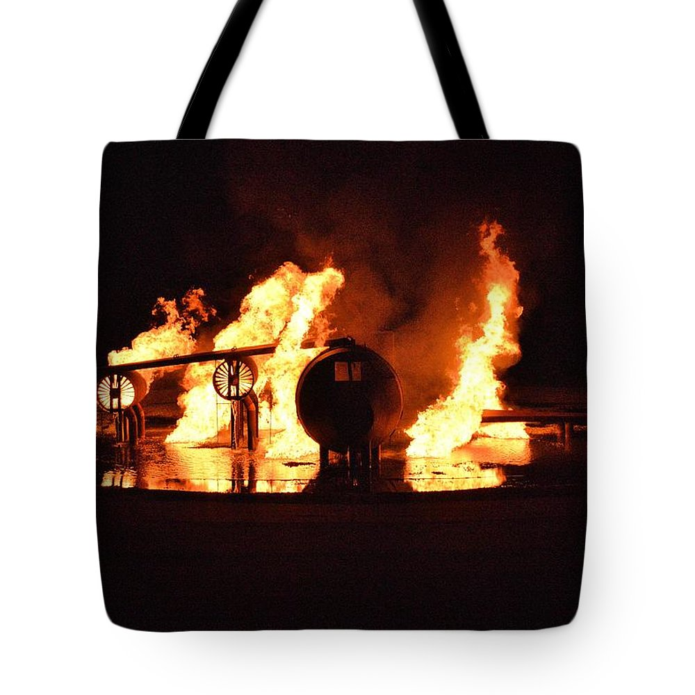 Burning Tote Bag featuring the photograph Plane Heats Up by Aaron Martens