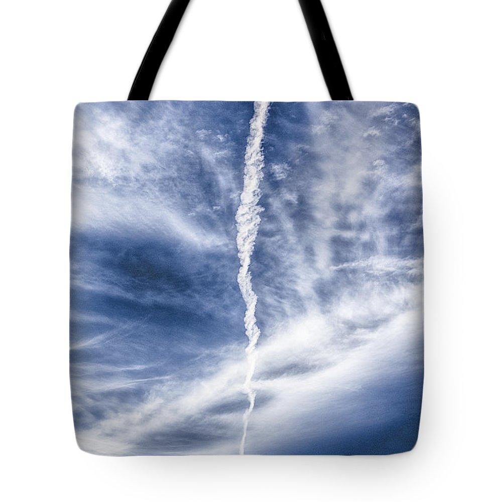Aircraft Tote Bag featuring the photograph Plane Vapor Trail by Douglas Barnard