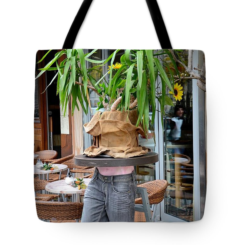 Table Tote Bag featuring the photograph Plant And Table Top Rests On Mannequin by Imran Ahmed