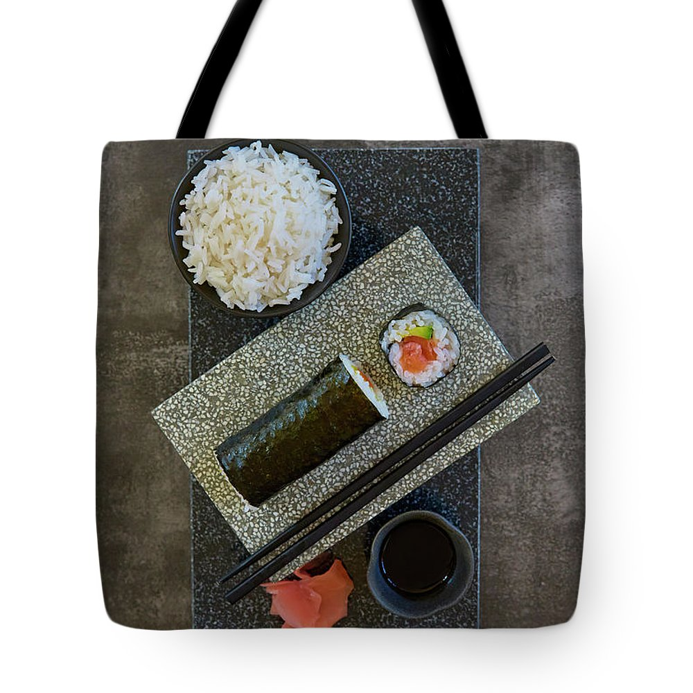 Hand Roll Tote Bag featuring the photograph Plate Of Sushi With Rice And Pickled by Colin Anderson Productions Pty Ltd