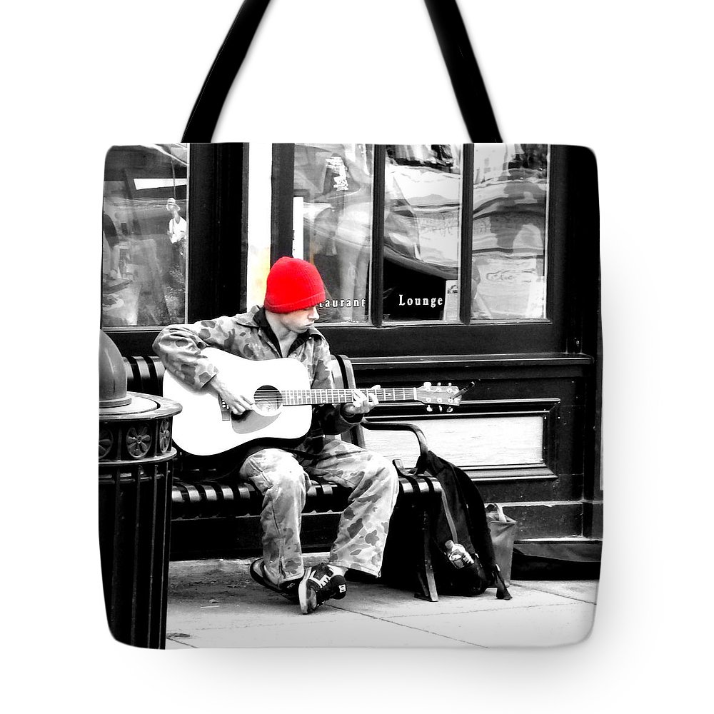Black And White Tote Bag featuring the photograph Playing To Get By by Jennifer B