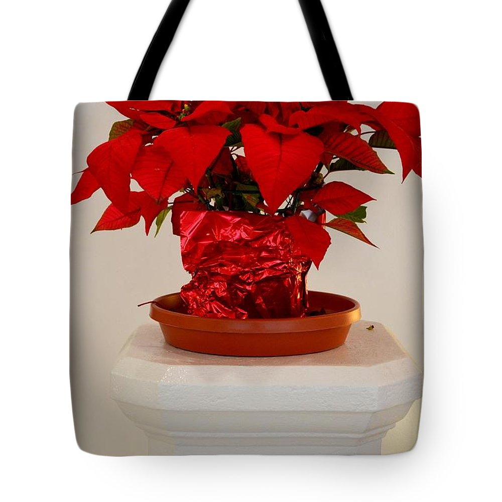 Poinsettia Tote Bag featuring the photograph Poinsettia On A Pedestal No 1 by Mary Deal