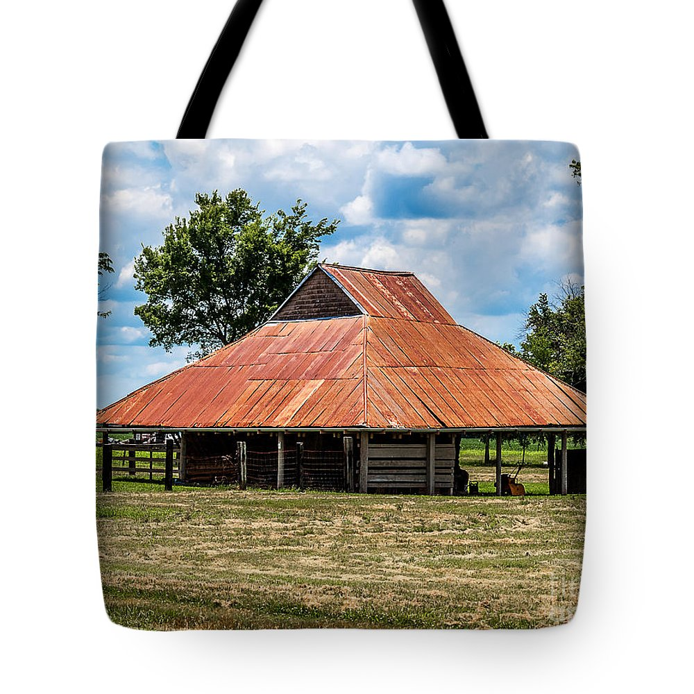 Bindery Tote Bag featuring the photograph Pole Barn by Ken Frischkorn