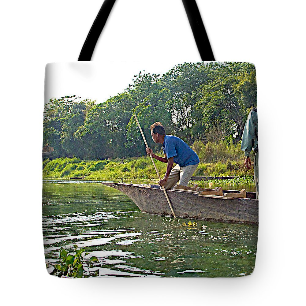 Poling A Dugout Canoe In Rapti River In Chitwan National Park In Nepal Tote Bag featuring the photograph Poling A Dugout Canoe In The Rapti River In Chitwan National Park-nepal by Ruth Hager