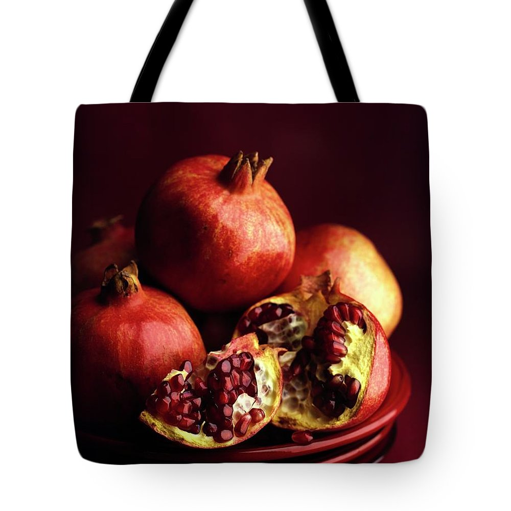 Fruits Tote Bag featuring the photograph Pomegranates by Romulo Yanes