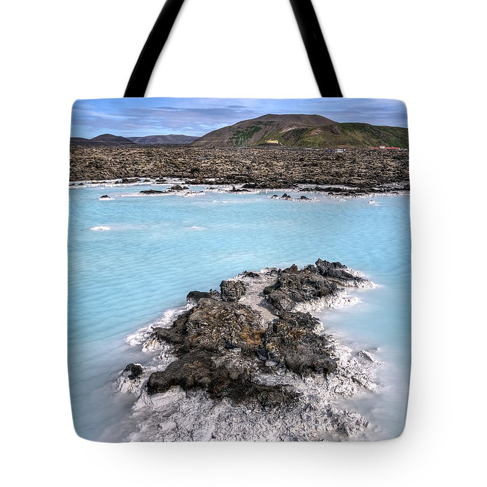 Grindavik Tote Bag featuring the photograph Pool Of Radiance by Evelina Kremsdorf