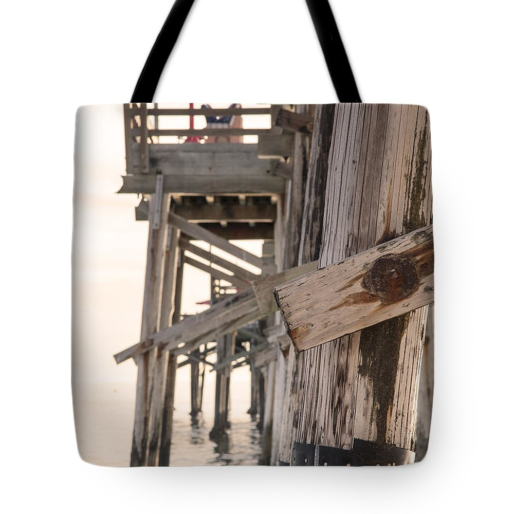 Balboa Pier Tote Bag featuring the photograph Portion Of The Pier Balboa by Chris Brannen