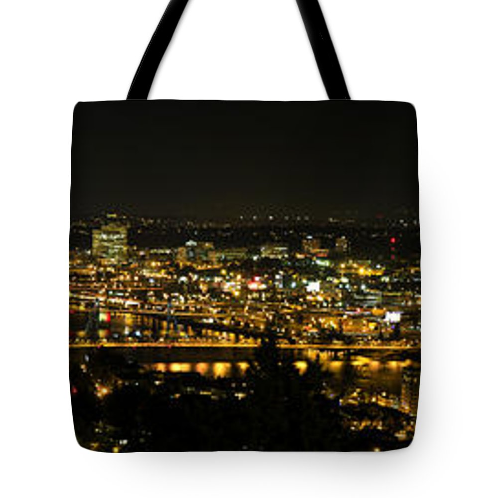 Portland Tote Bag featuring the photograph Portland Night Skyline Along Willamette River Panorama by David Gn