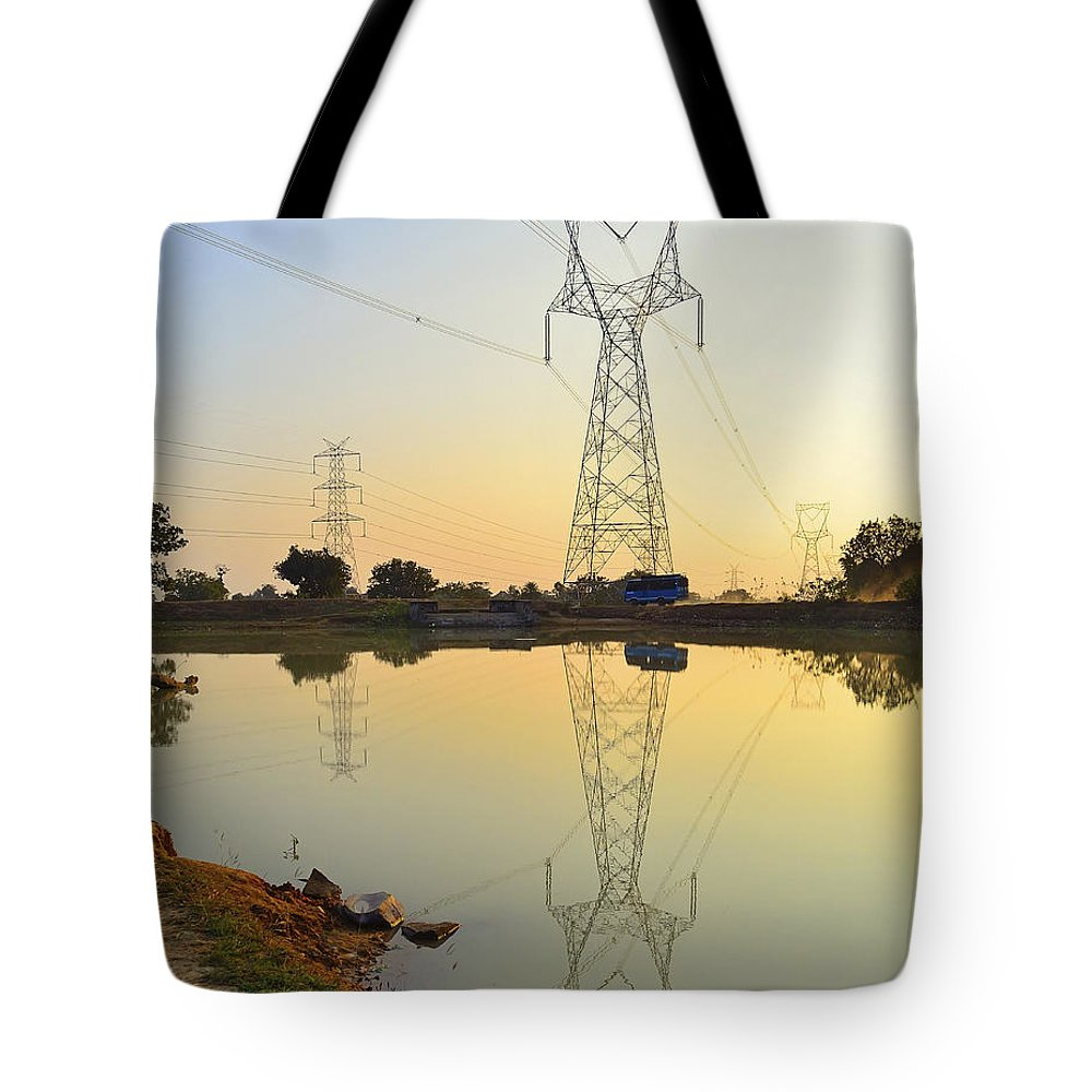 Powerline Tote Bag featuring the photograph Powerline And Pylons by Image World