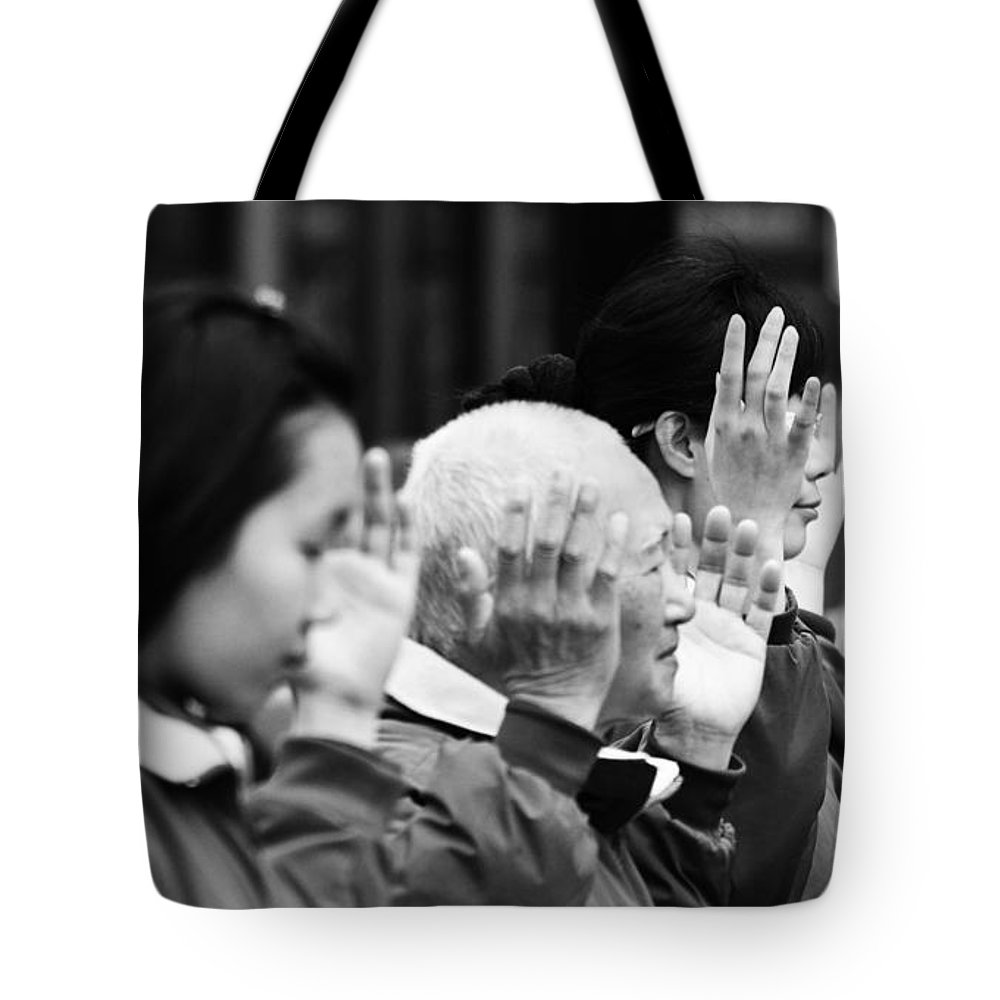 Street Photography Tote Bag featuring the photograph Praise by The Artist Project