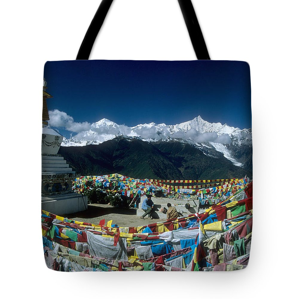 Himalaya Tote Bag featuring the photograph Prayer Flags In The Himalayan Mountains by James Brunker