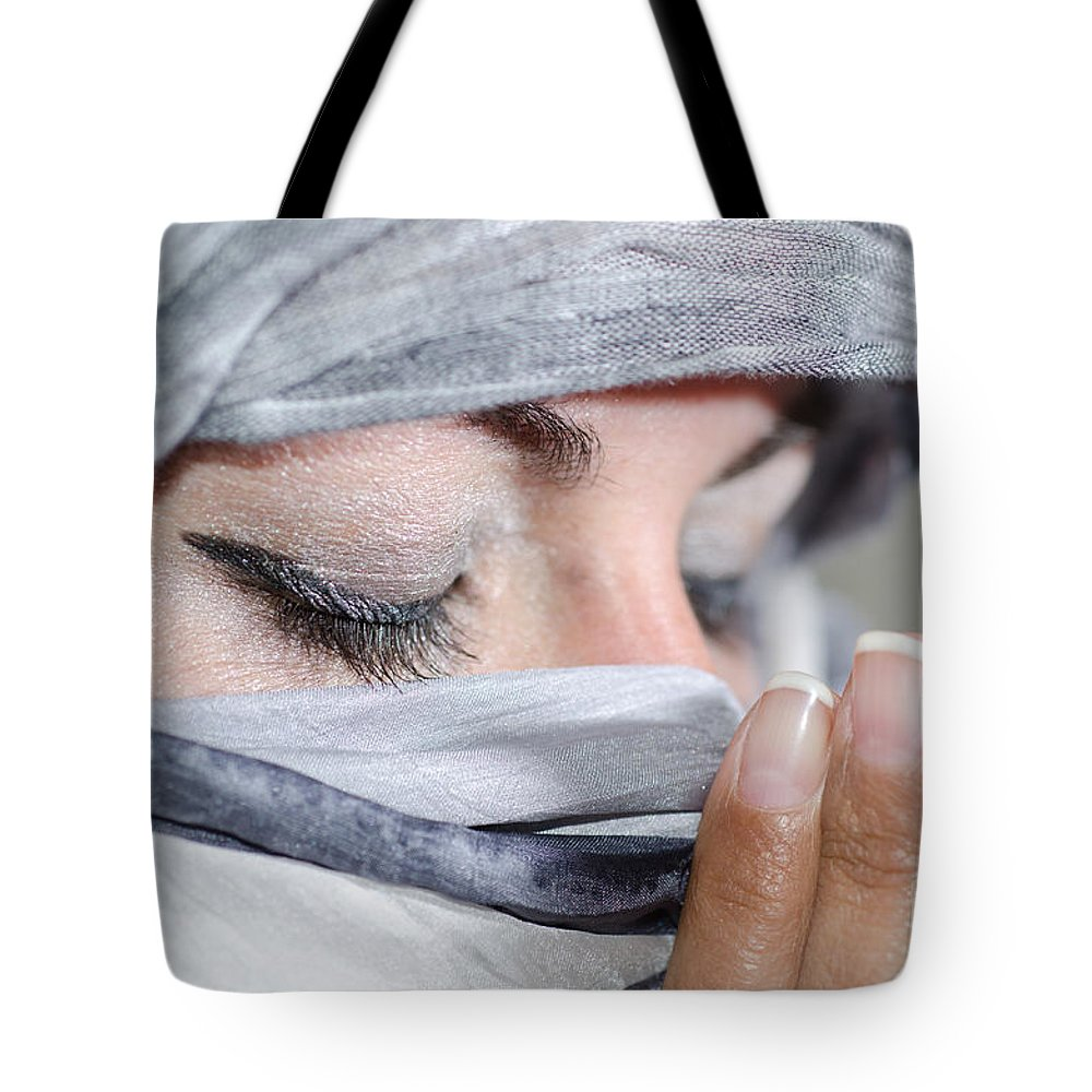 Women Tote Bag featuring the photograph Praying by Mats Silvan