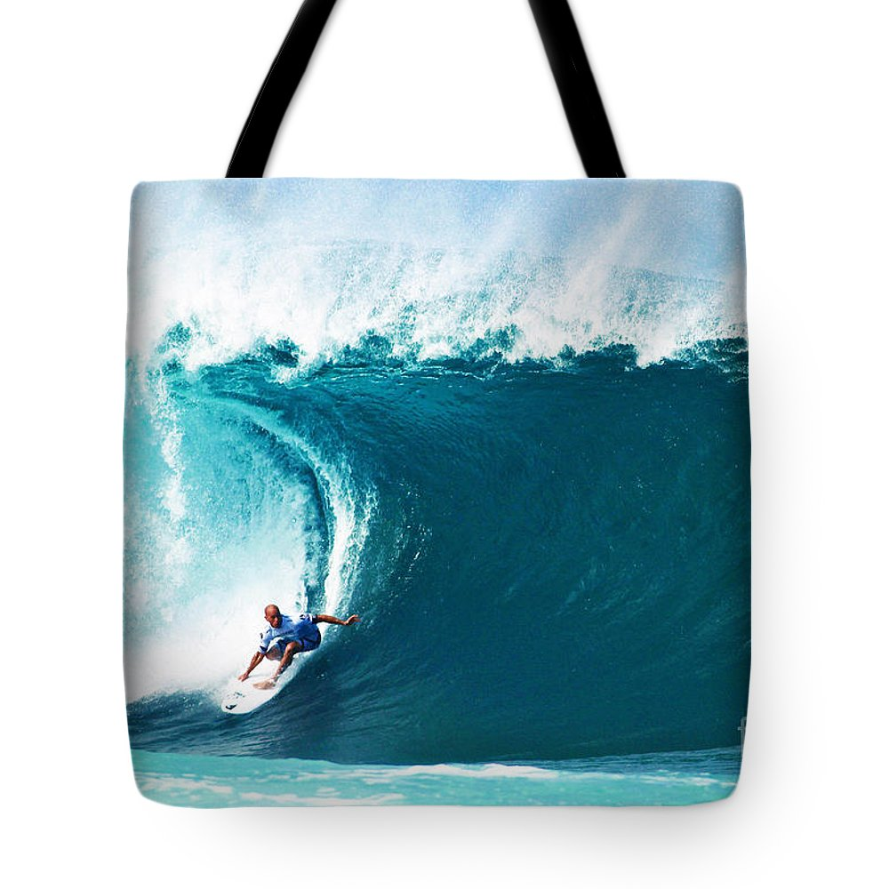Kelly Slater Tote Bag featuring the photograph Pro Surfer Kelly Slater Surfing In The Pipeline Masters Contest by Paul Topp