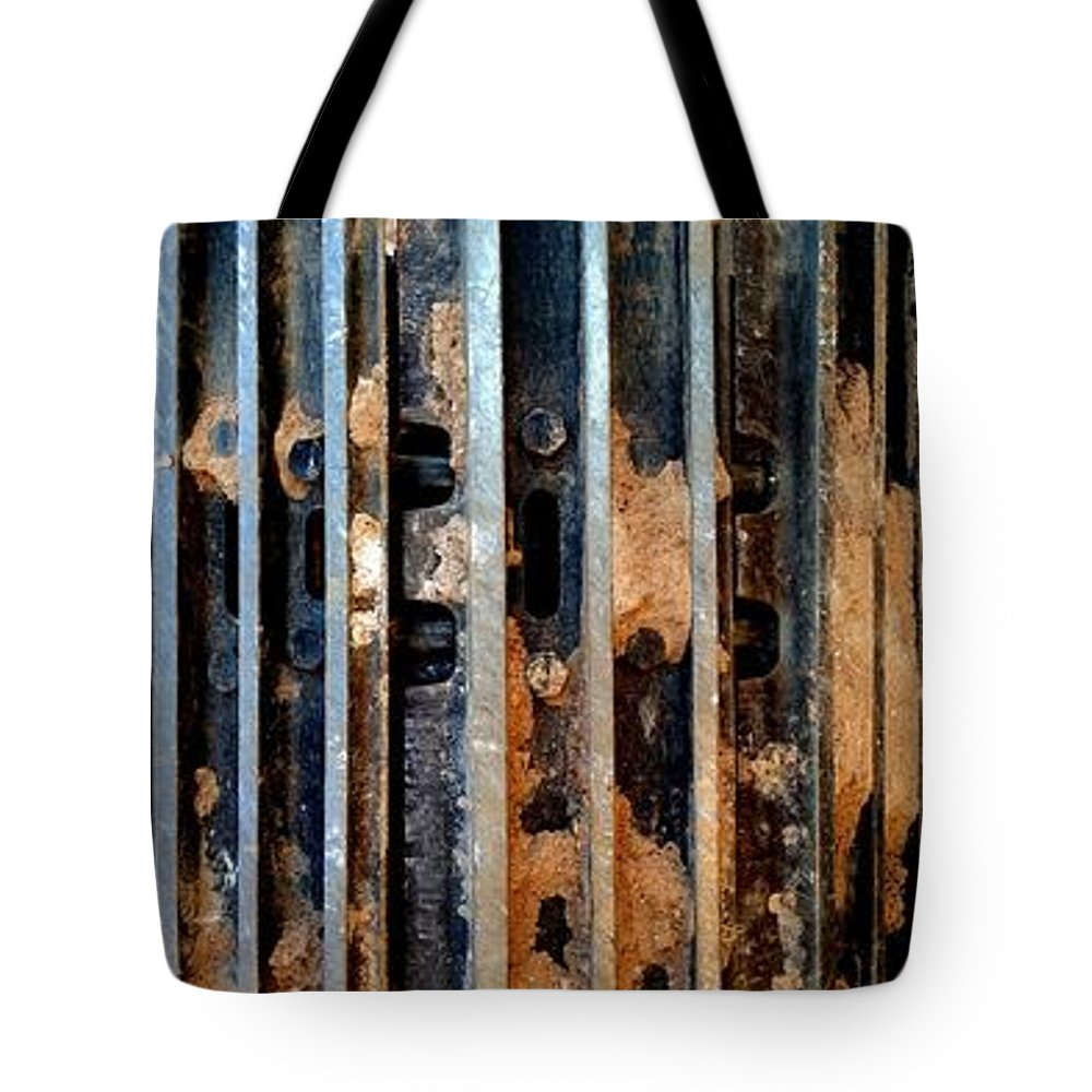 Construction Tote Bag featuring the photograph Pros And Cons Truction by Marlene Burns